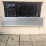 water door - adpated to fit around window -christchurch